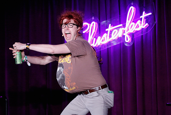 Mark Vigeant dressed as his character The Code Lord cracks open a Mountain Dew tallboy onstage at Comedy Central's Clusterfest in 2018