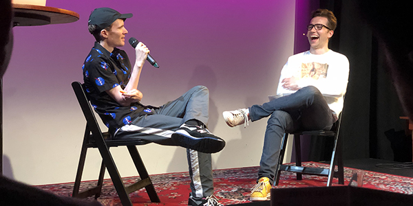 Bill Wurtz and Mark Vigeant seated onstage at CAVEAT in New York talking